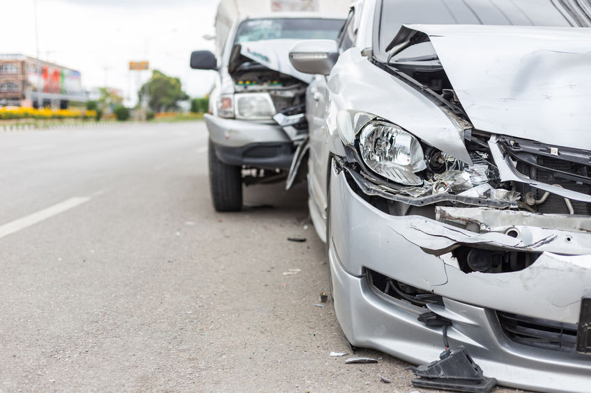 Modern car accident involving two cars on the road, Dan Rose Law, Car accident attorney